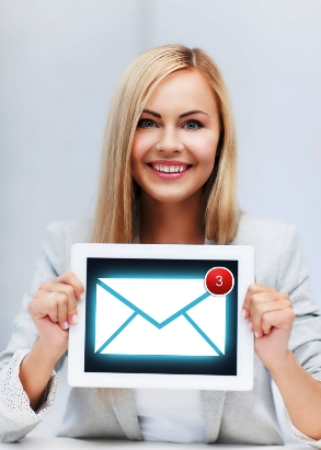 woman holding tablet pc with email sign