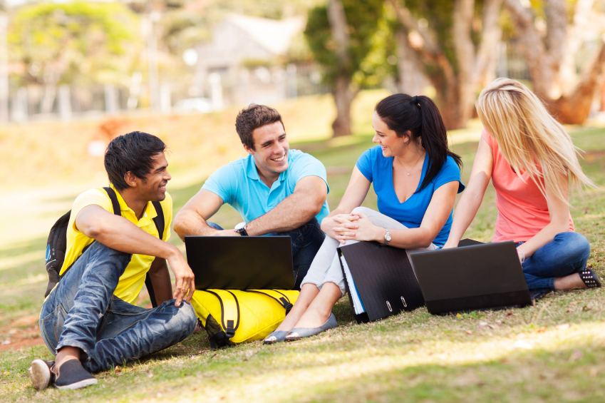 group of university students relaxing outdoors