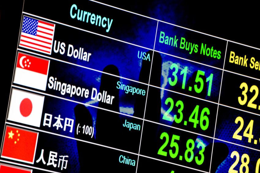 foreign currency exchange rate board with lighting hand in backg