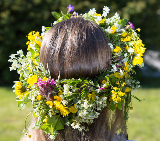 Swedish Midsummer Headgear Traditional on a female head of hair.