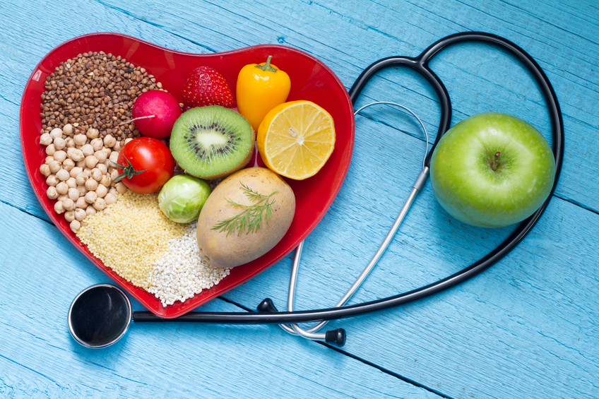Food on heart plate with stethoscope