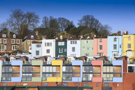 A mix of multicoloured houses in Bristol, on the banks of the floating harbour